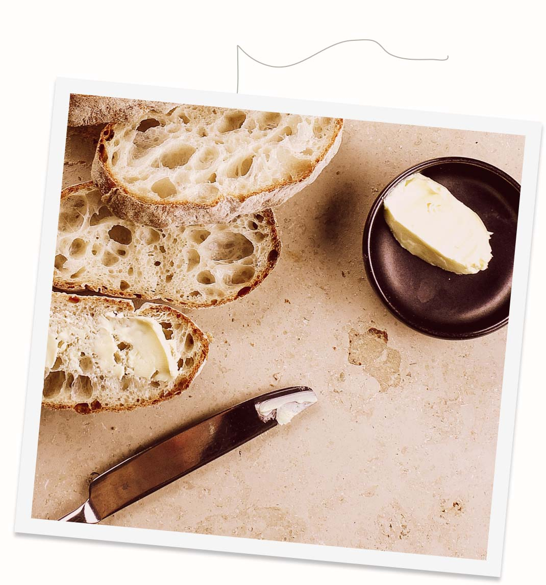 Photo of sliced sourdough bread and butter